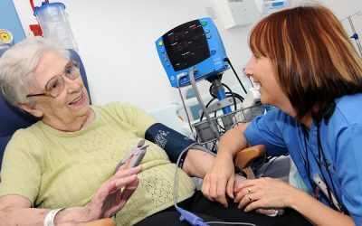 A nurse looking after an older lady