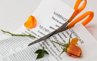 A marriage certificate being cut