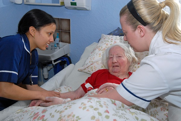 Image of an elderly patient being cared for
