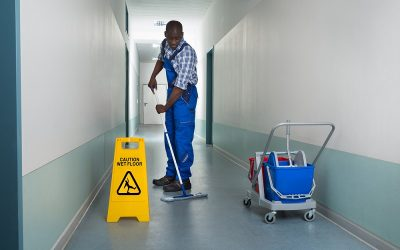 A man cleaning a floor