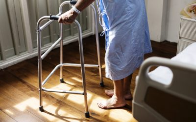 An older person with a walking frame