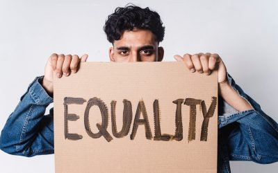 A man holding a sign saying equality