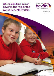 Two children in school. Cover photo for Lifting children out of poverty report