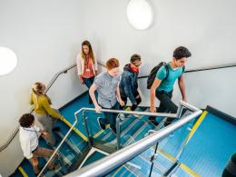 School children walking up stairs