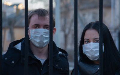 Two people in masks