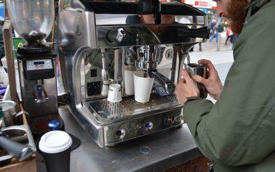 A man working at a coffee machine