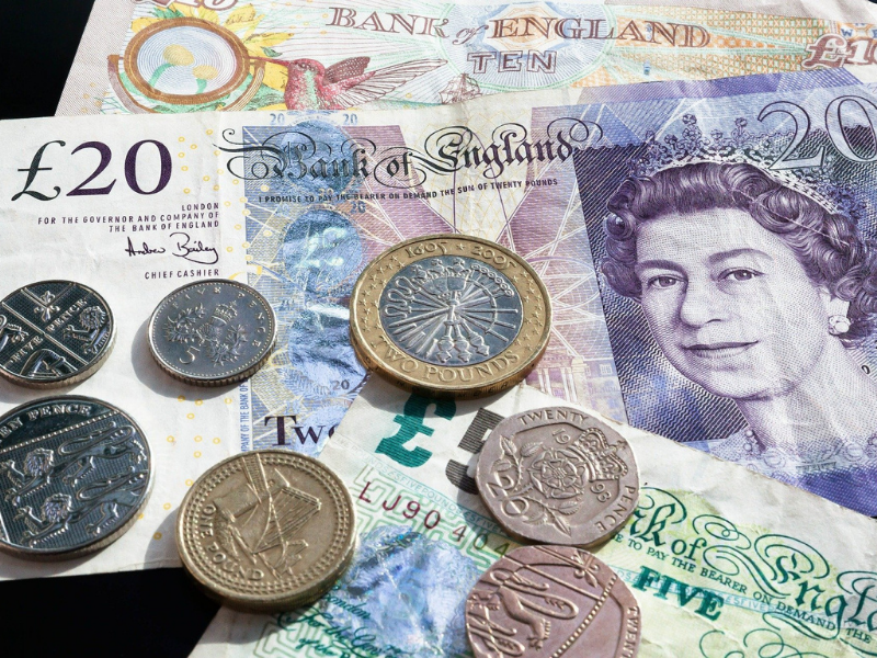 A variety of pound notes and coins