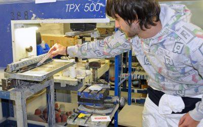 A man next to a machine