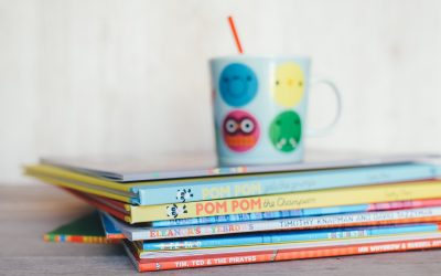 A cup on some books
