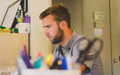 A man by a desk
