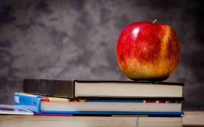 An apple on a book