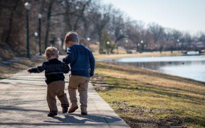 Children walking next to a lake