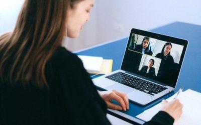 Worker viewing online meeting